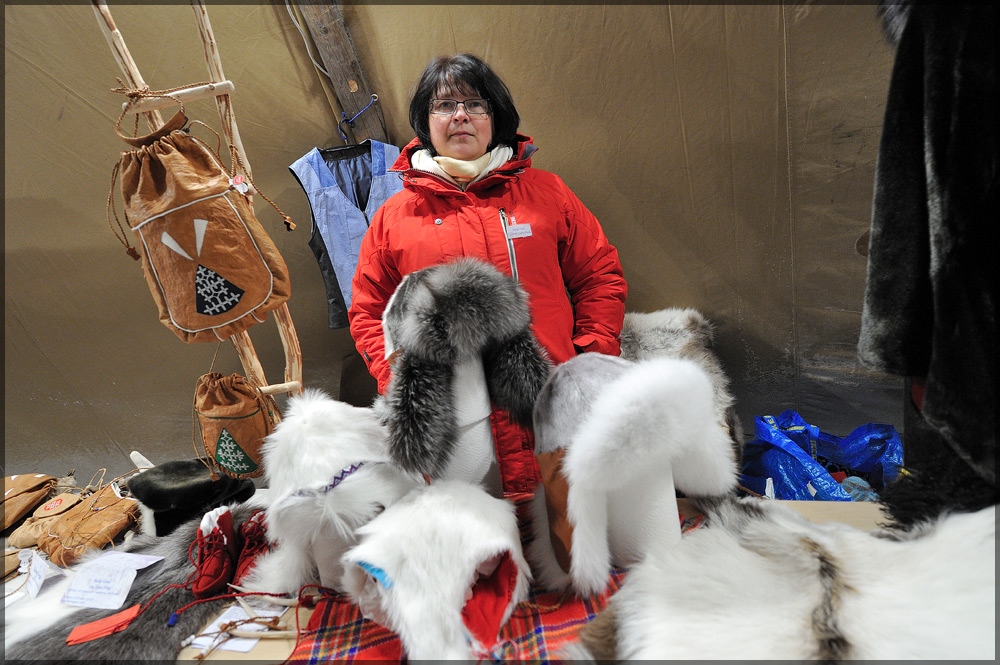 Lise Tapio Pittja selling some of her handicraft made of sealskin. (Radio Sweden)