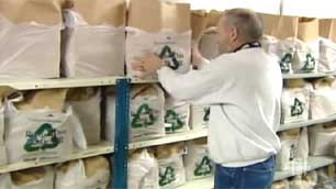 Dave Ritchie stocks shelves of food hampers at the Yellowknife Food Bank. (CBC)