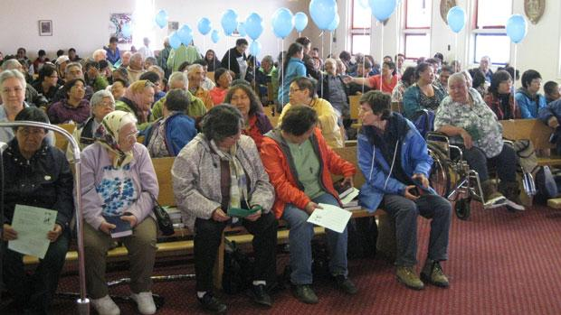 About 200 people attended a mass in Chesterfield Inlet Sunday to mark the 100th anniversary of the establishment of the first Roman Catholic misson in the Eastern Arctic. Some are wondering why there was no healing session planned, as the community was also home to a Catholic-run residential school. (Verna Strickland/CBC)