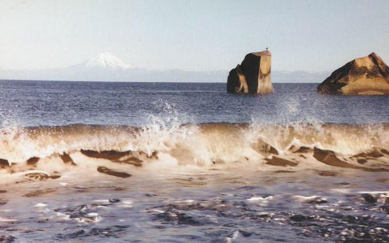 Waves crashing over rocks, Clam Gulch, Alaska. Photo courtesy Beeblebrox, under GNU public license.