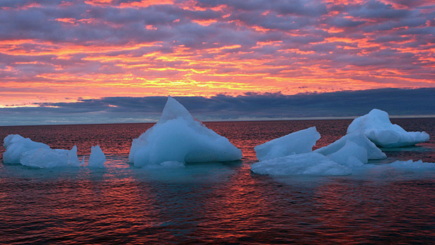 Ice floats in the Arctic Ocean as the sun sets near Barrow, Alaska. AP Photo/Arctic Sounder, Beth Ipsen