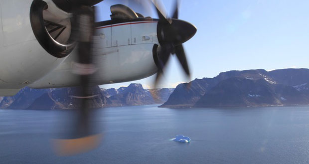 The National Aerial Surveillance Program's Dash 7 patrol aircraft flies over Hudson Strait on Tuesday. Observers aboard the aircraft scanned the Arctic waterway for ships and any sign of pollution, including oil spills. (Vincent Desrosiers, CBC)