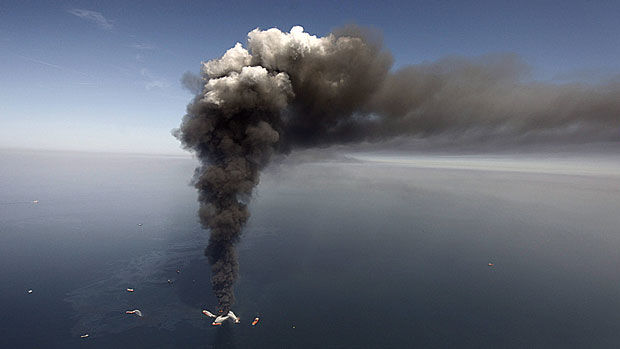 An oil spill at BP's Deepwater Horizon offshore oil rig in the Gulf of Mexico in April 2010 has cost $40 billion to clean up. Canada currently limits corporate liability for offshore oil spills to $30 million or $40 million, but the federal government is working on a bill to increase that cap. (Gerald Herbert/Associated Press)