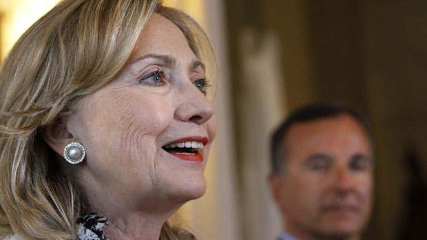 U.S. Secretary of State Hillary Clinton, left, talks to reporters in Rome on May 5, while Italian Foreign Minister Franco Frattini looks on. Clinton is attending the Arctic Council's ministerial meeting in Nuuk, Greenland, on Thursday. (Jacquelyn Martin/Pool/Associated Press)