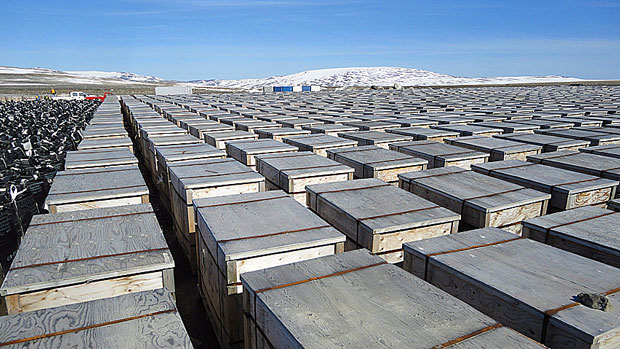 Thousands of containers of contaminated soil and other waste sit at an old Distant Early Warning System site at Cape Dyer, Nunavut, awaiting transport south in July, 2011. DEW line sites are some of the 142 contaminated sites that required clean up across Canada according to the most recent data. (Dave Eagles/DND/Canadian Press)