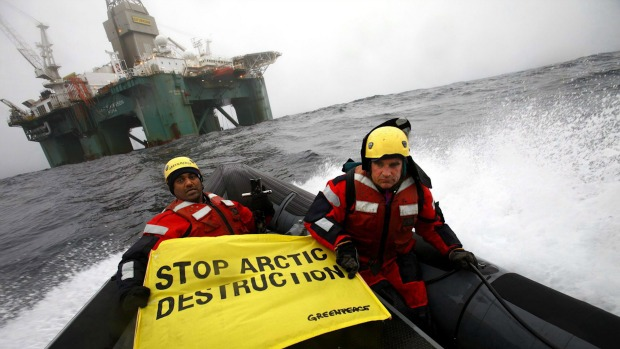 Greenpeace members hold a banner aboard a boat near an oil rig in the Davis Strait, off Greenland's west coast, Friday, June 17, 2011. (Greenpeace International, Jiri Rezac/The Canadian Press/AP)