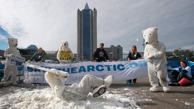 Greenpeace activists dressed as polar bears protest outside Gazprom's headquarters in Moscow, Russia, Wednesday, Sept. 5, 2012. Russian and international environmentalists are protesting against Gazprom's plans to pioneer oil drilling in the Arctic. (Misha Japaridze/AP Photo)