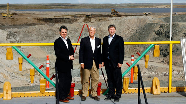 Prime Minister Stephen Harper, right, poses with then-Indian and Northern Affairs Minister Jim Prentice, left, and Tahera Diamond CEO Peter Gillin, in front of the mining pit before the official opening of the Jericho Diamond Mine project on Thursday, August 17, 2006, in Nunavut. Shear Diamonds bought the mine in 2010 after Tahera went bankrupt.) (CP PHOTO/Jeff McIntosh)