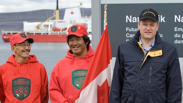 Prime Minister Stephen Harper poses for a photograph with Arctic Rangers in the Arctic port of Nanisivik, Nunavut, Friday, August 10, 2007.(CP PHOTO/ Fred Chartrand)