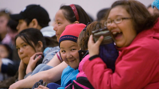 A group of children laugh at Maani Ulujuk school in Rankin Inlet, Nunavut, during a governor general's visit in 2009. According to 2011 census data, 32.5 per cent of Nunavut's population is under the age of 15. (Sean Kilpatrick/ Canadian Press )