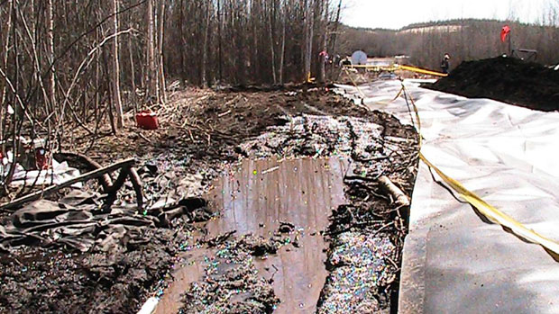 Workers clean up oil that leaked from Enbridge's Norman Wells pipeline near Wrigley, N.W.T., on May 9. The company estimates that 700 to 1,500 barrels of oil had leaked from the pipeline. Photo submitted by D'Arcy J. Moses.