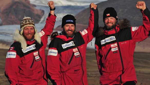 Devon McDiarmid, left, Adrian Hayes, middle, and Derek Crowe at the finish point of their Greenland kite-ski expedition on July 25, 2009. The trio recently learned their trek has set a Guinness World Record. (Emirates NBD Greenland Quest)