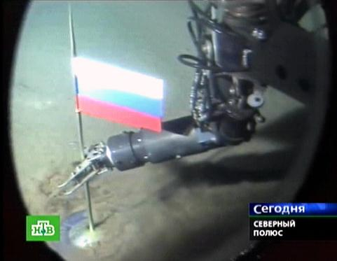 A Russian NTV channel grab taken 03 August 2007 shows a manipulator of the Mir-1 mini-submarine as it places a Russian state flag at the seabed of Arctic ocean at a depth of 4,261 meters (13,980 feet), 02 August 2007. Russian newspapers lauded members of an Arctic expedition who planted a Russian flag in the seabed four kilometres (2.5 miles) beneath the North Pole. AFP PHOTO / NTV