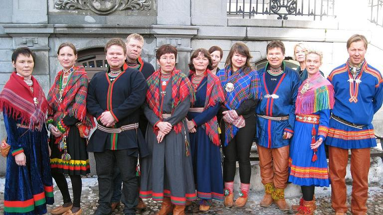 Sámi reindeer herders standing outside the High Court in Sotckholm. Photo: Sámi Radio