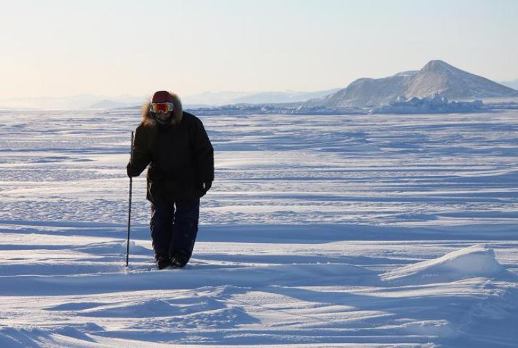 Inuit hunter Elijah Palituk looks for seal breathing holes in the ice off the coast of northeast Baffin Island in Canada's eastern Arctic territory of Nunavut. Photo: Levon Sevunts, Radio Canada International.