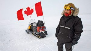 Canadian Ranger Joe Amarualik from Iqaluit stands beside his snowmobile during a sovereignty patrol near Eureka on Ellesmere Island, Nunavut, in 2007. Researchers will set up a world-class astronomical observatory on the island, which has some of the best sky gazing conditions in the world. (Jeff McIntosh/The Canadian Press)