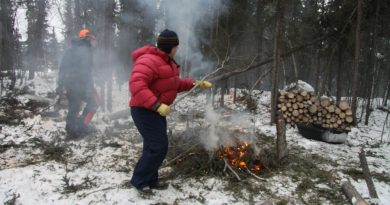 France and Doug are burning branches and brush to protect their log house from summer forest fires.