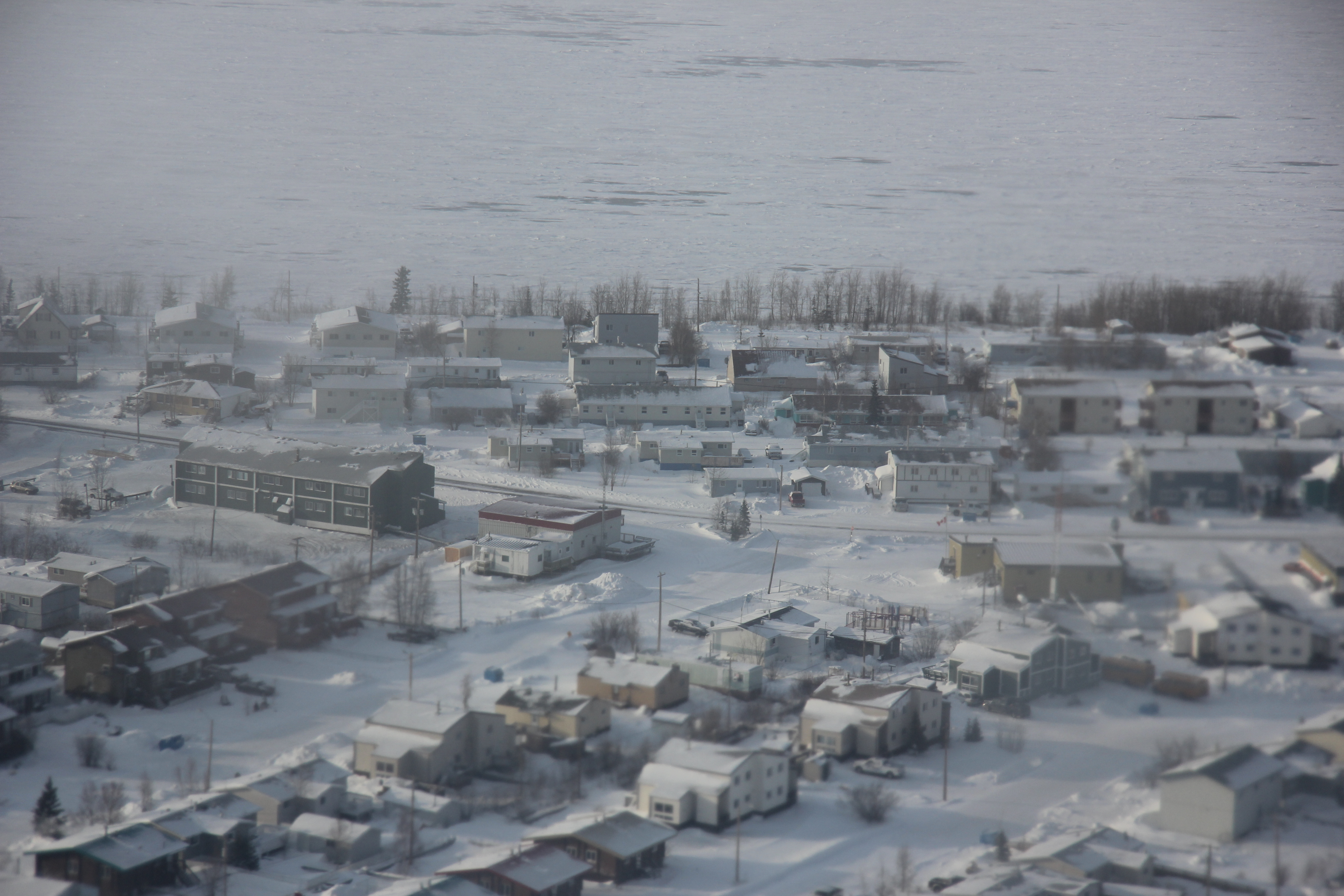 The Town of Norman Wells, N.W.T., is located close to where companies are exploring for oil and gas in the Sahtu region. The president of the Norman Wells Chamber of Commerce says local companies are happy ConocoPhillips' project was approved. (Eilís Quinn, Eye on the Arctic)