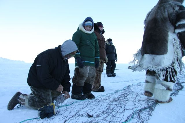 Inuit hunters set up seal nets under the ice near the community of Clyde River in Canada's eastern Arctic territory of Nunavut. (Levon Sevunts / Radio Canada International)