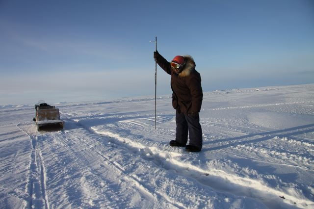Elijah Pallituq demonstrates how Inuit hunters use harpoons to hunt seals under sea ice. Photo by Levon Sevunts.