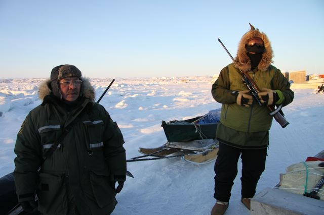 Inuit hunters on the outskirts of Iqaluit, Nunavut, prepare to leave for the seal hunt in the Frobisher Bay. Photo by Levon Sevunts.