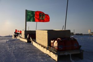 A Ranger and a Canadian flags fly on Inuit sleds loaded for an Arctic sovereignty patrol in the vicinity of the Canadian Forces Station Alert. Photo by Levon Sevunts.