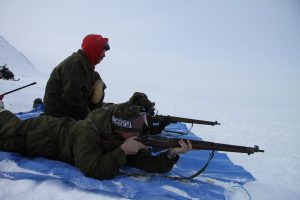 Soldiers practice shooting WW II-era Lee Enfield rifles used by the Canadian Rangers. Photo by Levon Sevunts.