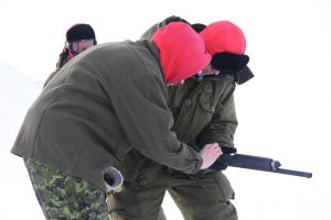 A Canadian Forces soldier learns how to use a shotgun. Photo by Levon Sevunts.