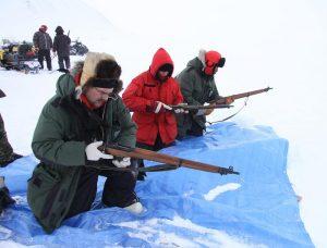Canadian Rangers load their rifles. Photo by Levon Sevunts.