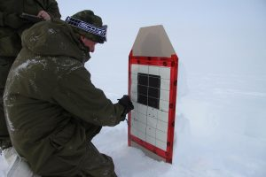 A Canadian soldier marks his shots on the paper target. Photo by Levon Sevunts.