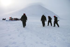 Soldiers walk back to the firing line after inspecting their targets. Photo by Levon Sevunts.