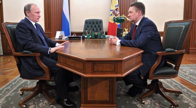 Russia's President Vladimir Putin (L) and Gazprom CEO, Alexei Miller, during a meeting on April 3, 2013. (Alexei Nikolsky, RIA-Novosti, AFP)