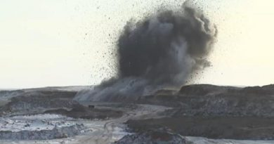 An explosion near Tuktoyaktuk releases gravel at the beginning highway construction season in 2014. (CBC)
