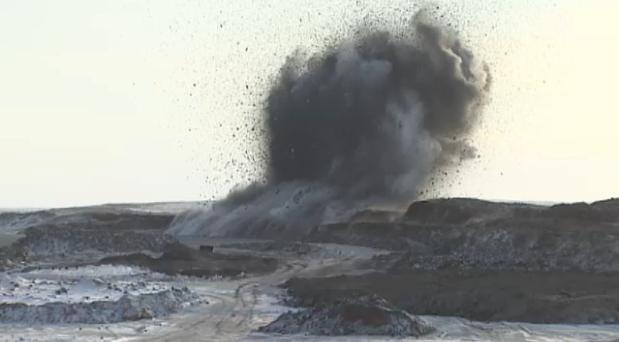 An explosion near Tuktoyaktuk releases gravel at the beginning highway construction season in 2014. (CBC)