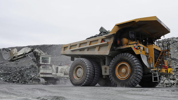 Miners work in the open pit mine at Agnico-Eagle's Meadowbank site in August 2011. The mine is situated 75 km north of Baker Lake, Nunavut. (The Canadian Press)