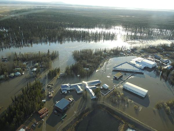 Homes and other buildings shown flooded in Galena, Alaska. (Ed Plumb / National Weather Service / AP)