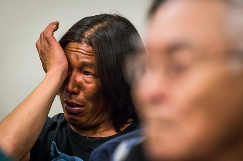A defendant wipes away tears after listening to testimony by elder Noah Okoviak. Both were cited after defying an emergency closure last summer. May 20, 2013. (Loren Holmes / Alaska Dispatch)