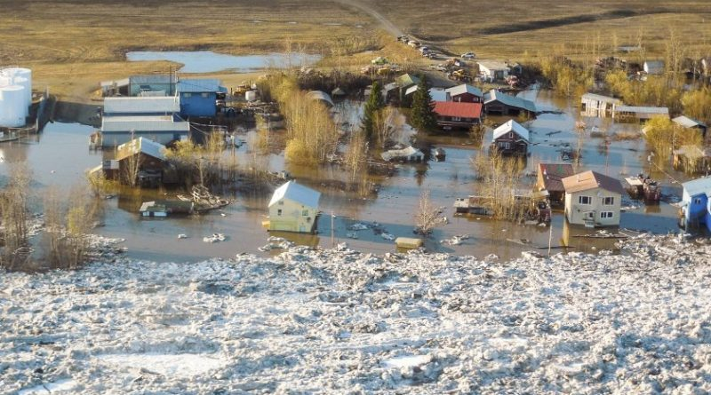 Homes and other buildings are shown flooded in Galena, Alaska. (Ed Plumb, National Weather Service, AP)