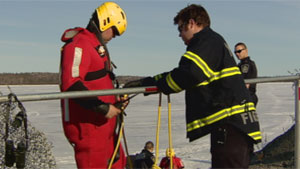 Yellowknife fire crews donned ice rescue gear to help a man and his dogs who fell through ice on Yellowknife Bay Friday. (CBC)