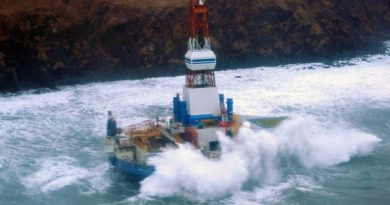 Waves crash over the mobile offshore drilling unit Kulluk where it sits aground on the southeast side of Sitkalidak Island, Alaska, Jan. 1, 2013. (US Coast Guard photo)