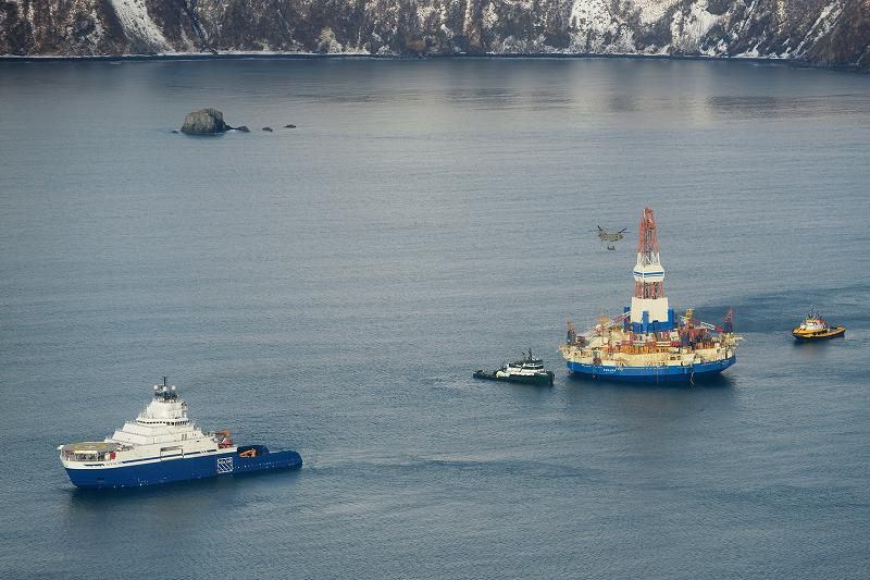 The drilling unit Kulluk, towed by the anchor-handling vessel Aiviq, heads to its safe harbor location in Kiliuda Bay. (Courtesy Shell, Alaska Dispatch)