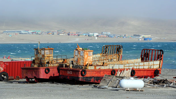 The hamlet of Resolute is seen beyond two barges on the shore of Resolute Bay in 2011. (Sean Kilpatrick/Canadian Press)