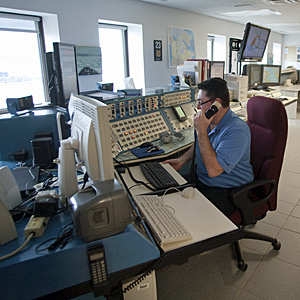 A member of the Canadian Coast Guard sits in the Marine Communications and Traffic Service operation in Iqaluit in 2009. (Andy Clark/Reuters)