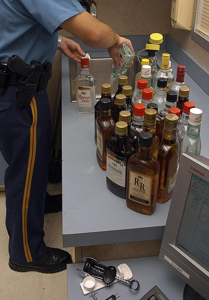 Illegal alcohol is a long-standing problem. This photo shows an Alsaka State Trooper dumping out illegal alcohol seized from bootlegging busts in Alaska in 2007.  (Alaska State Troopers / AP Photo/)