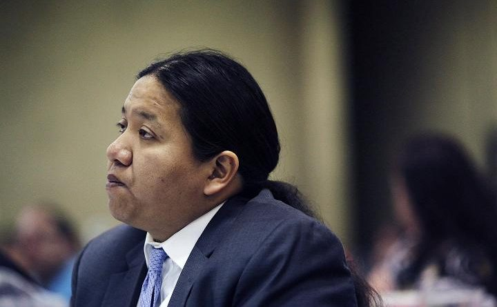 Rep. Kevin Killer listens to testimony during the Indian Child Welfare Act summit Wednesday, May 15, 2013 in South Dakota. (Benjamin Brayfield / Rapid City Journal / AP)