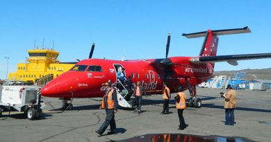 Passengers exit an Air Greenland Dash 8 after arrival at the Iqaluit airport from Nuuk last summer. This year's first flight of the year was cancelled, possibly due to lack of demand. (Daniel MacIsaac/CBC)
