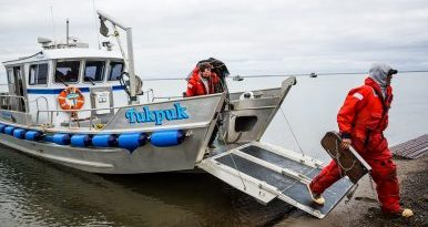 Workers disembark from a Shell Oil / Olgoonik Corporation oil spill response vessel, after a training exercise. August 30, 2012. (Loren Holmes, Alaska Dispatch)