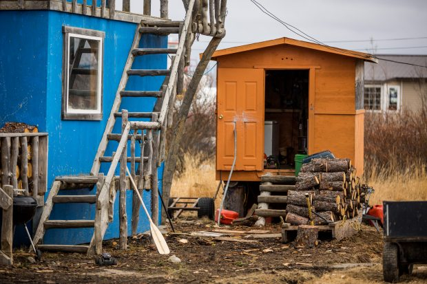 Firewood cut and stacked outside a Bethel home (May 22, 2013). Bethel community leaders are searching for creative ways to solve a housing shortage, and long-term plans are in the works. But short-term needs are real in the Southwest Alaska regional hub. (Loren Holmes / Alaska Dispatch)
