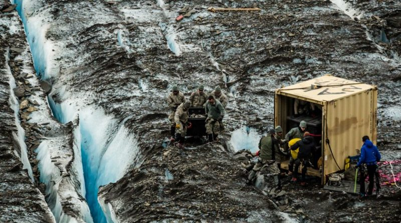 Military personnel recovering the remains of a C-124 air plane that crashed on Colony glacier in 1952. July 12, 2012 (Loren Homes / Alaska Dispatch)