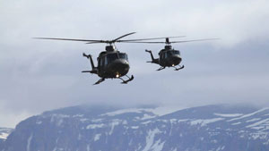 Two Royal Canadian Air Force helicopters fly near Arctic Bay, Nunavut, on Wednesday. The aircraft arrived in the area to rescue hunters and tourists stranded by drifting ice. (Photo courtesy of Niore Iqalukjuak)
